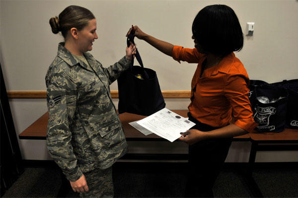 Airman receives a bundle from an Airman and Family Readiness Center community readiness consultant, after the Bundles for Babies seminar Jan. 23, 2013, at Buckley Air Force Base, Colo. (U.S. Air Force photo by Airman 1st Class Riley Johnson/Released)