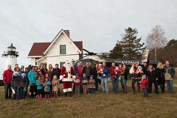 Coast Guard members from Civil Engineering Unit Providence and their family members attend a Friends of Flying Santa event at Warwick Lighthouse, R.I., Sunday, Dec. 13, 2015. (U.S. Coast Guard/PO3 Andrew Barresi)
