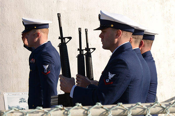 Members of Coast Guard Station Cape Disappointment prepare for the 21-gun salute during a memorial ceremony that honored Coast Guardsmen and fishermen who have perished along the Columbia and Quillayute Rivers. (U.S. Coast Guard/PO3 Jonathan Klingenberg)