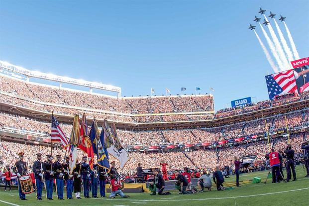 The Navy Blue Angels perform a flyover concluding the opening ceremony of Super Bowl 50 at Levi's Stadium in Santa Clara, Calif., Feb. 7, 2016. (Army Photo by Spc. Brandon C. Dyer)