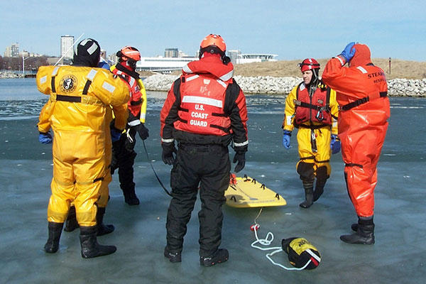 Members from Coast Guard Station Milwaukee and local first responders prepare for a rescue drill during ice rescue training in Milwaukee, Feb. 28, 2016. (Coast Guard photo by Lt. j.g. Tom Morrell)