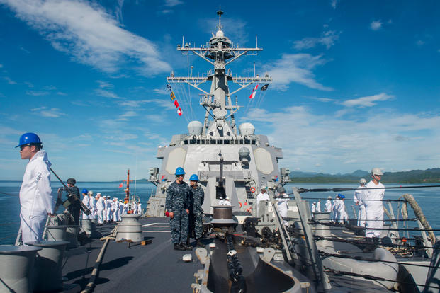 Sailors man the rails aboard the guided-missile destroyer USS William P. Lawrence (DDG 110) as the ship pulls into Suva, Fiji for a scheduled port visit. (Photo: Mass Communication Specialist 3rd Class Emiline L. M. Senn)