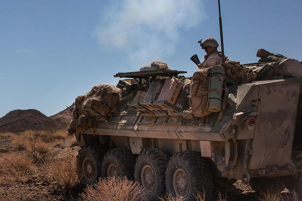 A Marine with Company B, 3rd Light Armored Reconnaissance Battalion, fires a light armored vehicle mounted mortar in the Combat Center training area at Twentynine Palms. (U.S. Marine Corps/Lance Cpl. Levi Schultz)
