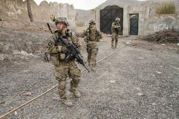 "FILE -- An infantryman assigned to 3rd Brigade Combat Team ""Rakkasans,"" 101st Airborne Division double checks the team's rear security near Combat Outpost Bowri Tana, Afghanistan, Dec. 2, 2012. (Photo Credit: Sgt. 1st Class Abram J Pinnington)"
