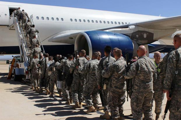 FILE -- Soldiers board their plane for deployment at Libby Army Airfield. (Photo Credit: Gabrielle Kuholski)