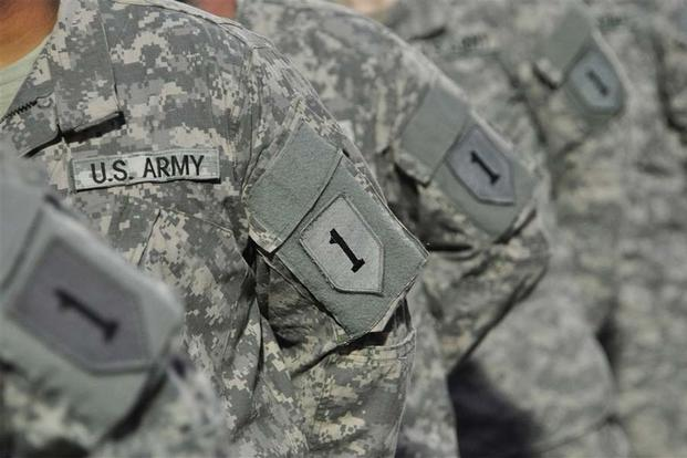 FILE -- About 350 U.S. Army Soldiers with 1st Infantry Division received their combat patches during a ceremony at turf field, Camp Lemonnier, Djibouti, July 27, 2013.. (U.S. Air Force photo/Tech. Sgt. Chad Thompson)