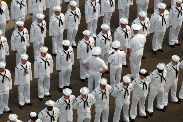 Sailors stand ready to be inspected. (Navy Photo)