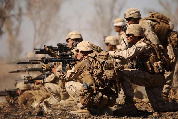 Marines with Company B, 1st Battalion, 1st Marine Regiment -- part of Marine Rotational Force Darwin -- attack an objective during a live-fire range movement at Bradshaw Field Training Area in Australia, on Aug. 10, 2016. Sarah Anderson/Marine Corps