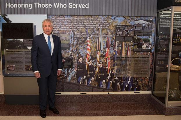 Former Secretary of Defense Chuck Hagel stands next to his quote in a hallway dedicated to veterans of the Vietnam War at the Pentagon in Washington, D.C., Dec. 20, 2016.  (DoD Photo/Staff Sgt. Jette Carr)