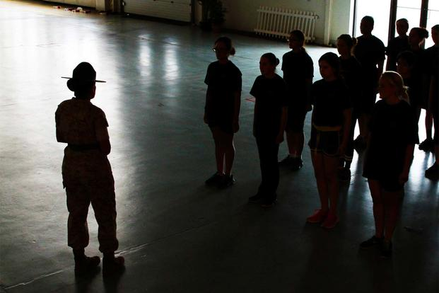 A drill instructor from Marine Corps Recruit Depot Parris Island, S.C., teaches Marine Corps Drill to female poolees, women currently enrolled in the Marine Corps' Delayed Entry Program. (Sgt. Richard Blumenstein/Marine Corps)