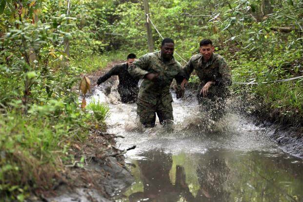 Marines with Combat Logistics Regiment 2 splash their way through one of the many mud puddles during an endurance course at Camp Lejeune, N.C., April 22, 2016. (Marine Corps/ Lance Cpl. Brianna Gaudi)