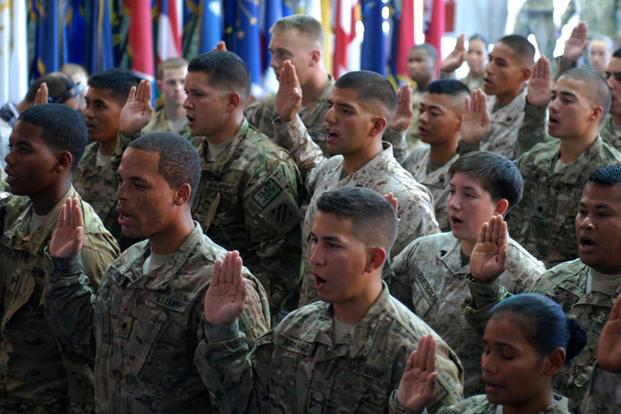 FILE -- Thirty-seven service members from 22 different countries take the Oath of Allegiance during a naturalization ceremony held at Bagram Air Field, Afghanistan on July 4, 2013. (Army/Sgt. Anita VanderMolen)