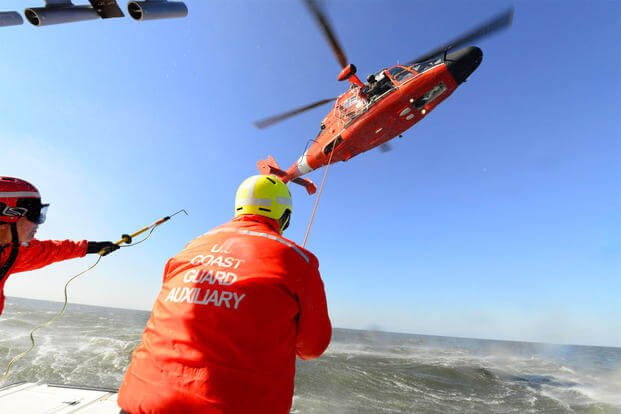 Auxiliarists with Flotilla 4-8 conduct rescue basket training with a Coast Guard Air Station New Orleans MH-65 Dolphin helicopter. (Photo: 8th Coast Guard District)