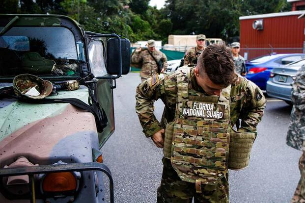 FILE -- Soldiers from 2nd Battalion, 124th Infantry Regiment, prepare to head out to assist with Hurricane Matthew relief efforts in Fern Creek, FL, October 8, 2016 (U.S. Army/Spec. James M. Lanza, 107th MPAD)