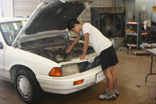 Engine repair in white car.