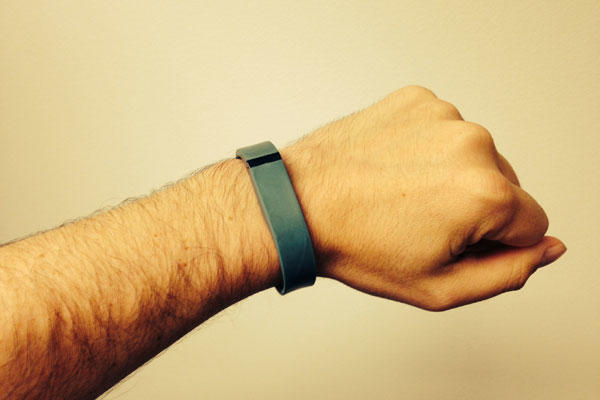 Steve Whitman shows off his FitBit Flex wristband.