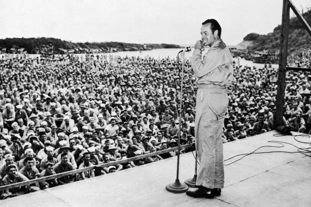 Bob Hope performs for servicemen at Munda Airstrip, New Georgia on October 31,1944.