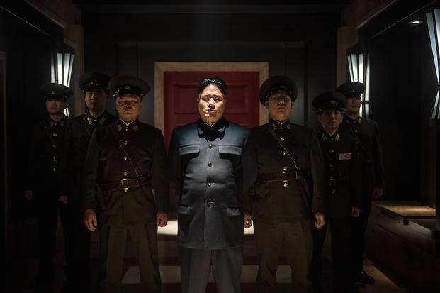 "This photo provided by Columbia Pictures - Sony shows, Randall Park, center, as Kim Jong Un in Columbia Pictures' ""The Interview."" (AP Photo/Columbia Pictures - Sony, Ed Araquel)"