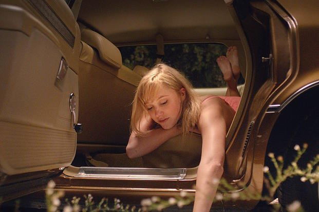 "This image released by RADiUS shows Maika Monroe in a scene from ""It Follows."" (AP Photo/RADiUS)"