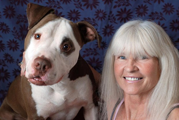 "n this Tuesday, Nov. 11, 2014 photo provided by Smiling Dog Rescue, Rica Powell poses with Truman, a 4-year-old pit bull who will be up for adoption on ""Fox's Cause for Paws: An All-Star Dog Spectacular."""