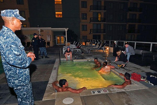 1st Class Petty Officer Christopher Yates talks to a group of sailors about drinking and activities at a roof top spa at one of the on base residences at the 32nd Street Naval base in San Diego. Lenny Ignelzi/AP