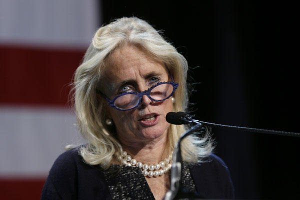In this Nov. 4, 2014 file photo, Rep.-elect Debbie Dingell, D-Mich. speaks during an election night rally in Detroit. Carlos Osorio/AP