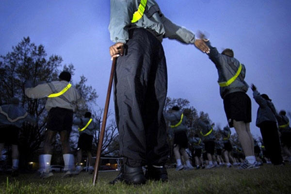 Soldiers assigned to a Warrior Transition Brigade take part in morning physical training. Army photo