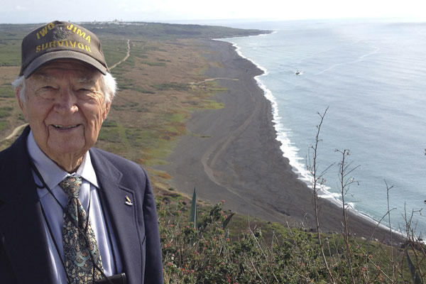 In this March 21, 2015, photo, Norman Baker of Delaplane, Va., smiles atop Mount Suribachi on Iwo Jima after attending a memorial for the 70th anniversary of the battle of Iwo Jima. Courtesy of Norman Baker via AP