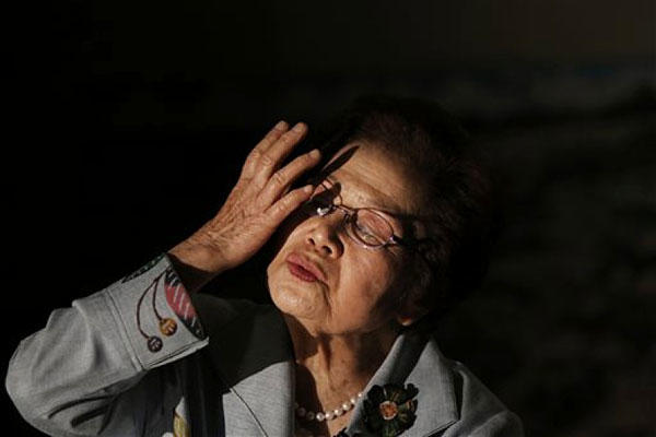 Yoshiko Shimabukuro, a survivor of the Himeyuri Student Nurse Corps 70 years ago, speaks about the battle of Okinawa during World War II during an interview with The Associated Press on Okinawa in March 2015. Eugene Hoshiko/AP