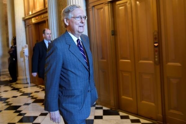 Senate Majority Leader Mitch McConnell of Kentucky walks to a Republican luncheon on Capitol Hill in Washington, Friday, May 22, 2015. (AP Photo/Susan Walsh)