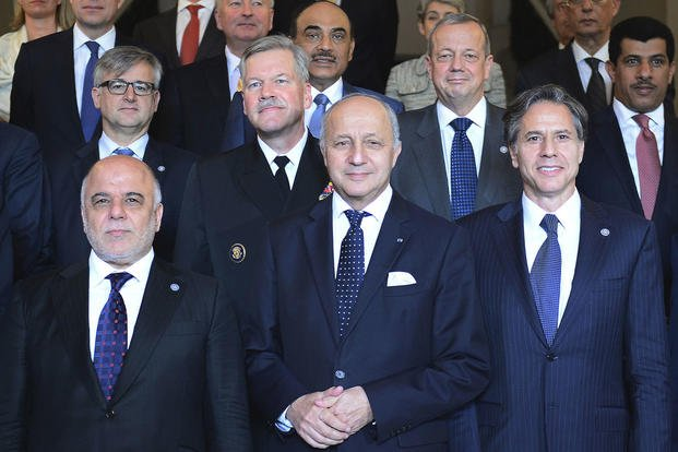 First row from left: Iraqi Prime Minister Haider al-Abadi, French Foreign Affairs Minister Laurent Fabius and U.S. Deputy Secretary of State Antony J. Blinken pose after a meeting in Paris on June 2. Stephane de Sakutin/Pool Photo via AP