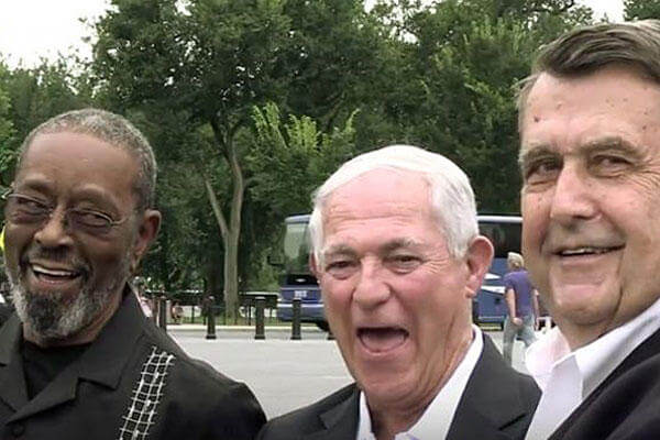 "This screen capture from a State Department video shows F.W. ""Mike"" East, left; Larry C. Morris, center; and Jim Tracy in Washington, D.C. The three former Marines lowered the U.S. flag at the American embassy in Cuba in 1961."
