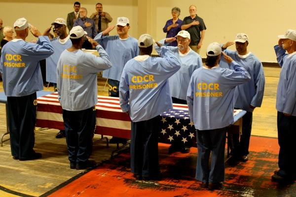 Incarcerated veterans at California's Correctional Training Facility salute before folding the US flag. (California Dept.   of Corrections and Rehabilitation)
