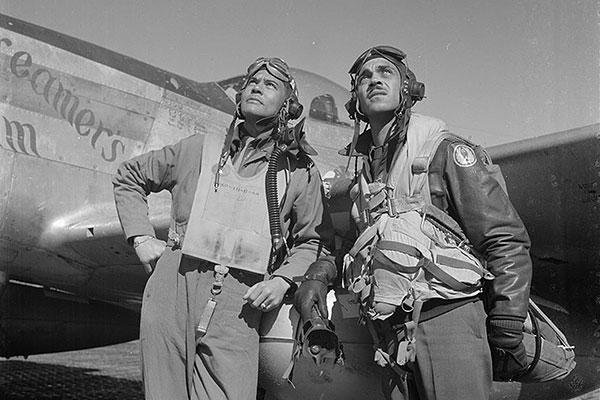 "Col. Bengamin . Davis Jr. and Capt. Edward Gleed stand in in front of Lt. Charles White's ""Creamer's Dream"". (U.S. Air Force photo)"