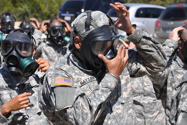 Army Capt. (Dr.) Tejdeep Singh Rattan checks the seal on his gas mask before entering the gas chamber during nuclear, biological and chemical training at Camp Bullis, Texas, in 2010, when he attended the Basic Officer Leadership Course. Steve Elliott/Army