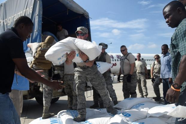 Staff Sgt. Angelo Morino, 621st Contingency Response Wing, transports food and provisions for Hurricane victims, October 9th, 2016, Port-Au-Prince, Haiti. (U.S. Air Force photo/Robert Waggoner)