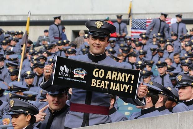A West Point cadet holds a sign at the 2015 Army-Navy Game at Lincoln Financial Field in Philadelphia. Navy beat Army 21–17. (Military.com photo/Michael Hoffman)