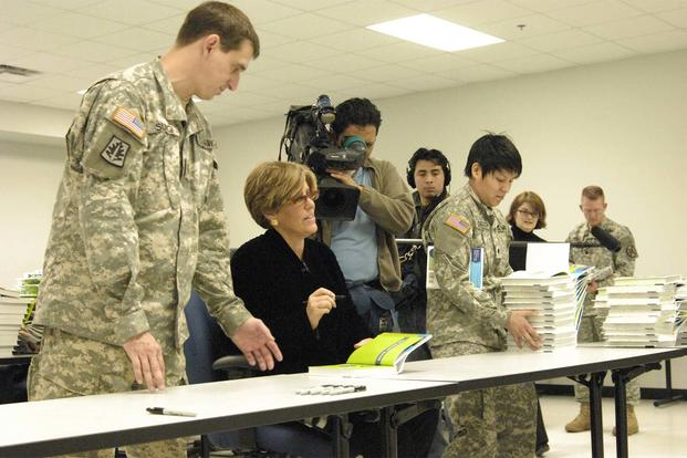 Financial advice guru Suze Orman signs books at Fort Dix, N.J. (Army Photo)