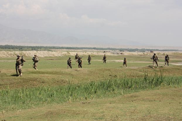 Soldiers from 3rd Brigade Combat Team, 101st Airborne Division (AASLT), patrol with Afghan National Army troops from 201st Corps conduct in Laghman province Sept. 23, 2015. (U.S. Army photo/Jarrod Morris)
