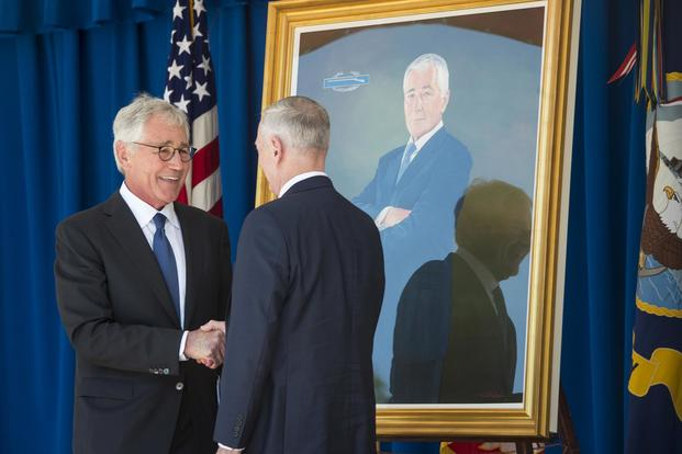 Defense Secretary Jim Mattis and former Defense Secretary Chuck Hagel attend the unveiling ceremony of Hagel's official portrait at the Pentagon on May 19, 2017. Tech. Sgt. Brigitte N. Brantley/Air Force