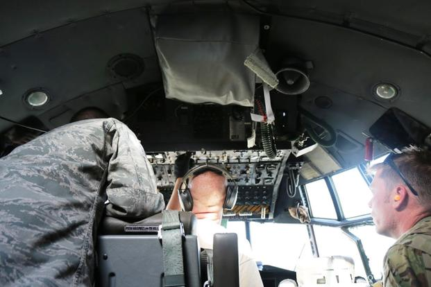 Crew with the 386th Air Expeditionary Wing work to fix a bogged down engine from the cockpit and the flightline in Iraq on June 28, 2017. (Military.com photo by Oriana Pawlyk)