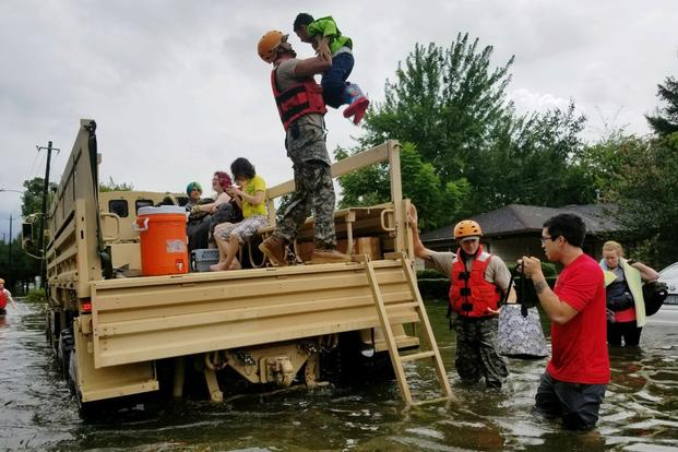 Texas National Guard soldiers arrive in Houston, Texas to aid citizens in heavily flooded areas from the storms of Hurricane Harvey. (Photo by Zachary West, 100th MPAD)