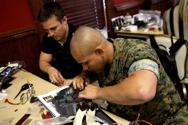 Marine and Contractor Assemble Nibbler Drone
