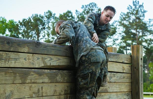 U.S. Army Soldiers display teamwork during the Ranger Course on Fort Benning, Ga., April 21, 2015. Soldiers attend the Ranger Course to learn additional skills in a physically and mentally demanding environment. (U.S. Army/Spc. Dacotah Lane/Released)