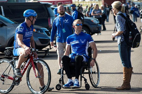 Ashley Means stands by her husband Jeremiah as they talk to other Air Force wounded warriors at the Warrior Games cycling event, Sept. 9, 2014, at Fort Carson, Colo. Senior Airman Jette Carr/Air Force