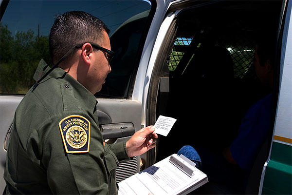 Border Patrol agent reads the Miranda rights to a Mexican national arrested for transporting drugs. (U.S. Dept. of Homeland Security photo)