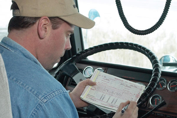 Truck driver logging hours