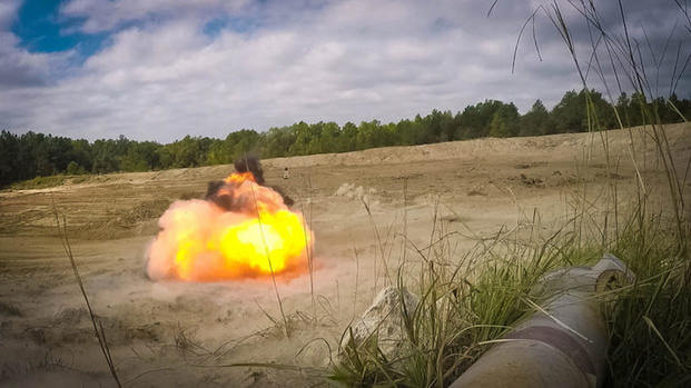 An M18A1 claymore mine detonates during a training exercise at Fort Bragg, N.C., Sept. 16, 2016. Soldiers from the 122nd Aviation Support Battalion, 82nd Combat Aviation Brigade, focus on improving the individual and collective combat skills of their Soldiers. (U.S. Army photo by Capt. Adan Cazarez)