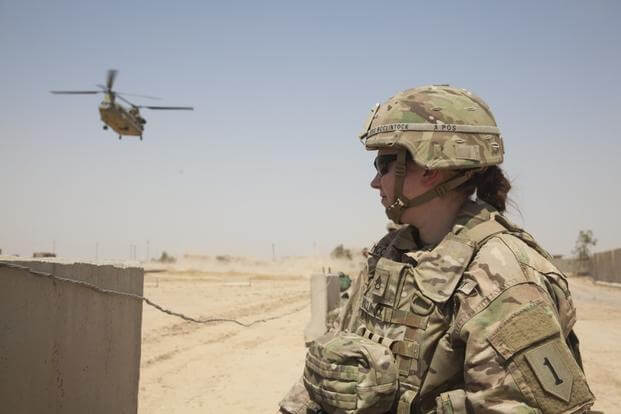 U.S. Army Staff Sgt. Heidi McClintock, deployed in support of Combined Joint Task Force-Operation Inherent Resolve and assigned to the Main Command Post Operational Detachment, 1st Infantry Division, waits for a CH-47 Chinook to land at a tactical assembly area near Mosul, Iraq, May 29, 2017. More than 60 Coalition partners have committed themselves to the goal of eliminating the threat posed by ISIS in Iraq and Syria and have contributed in various capacities to the effort. CJTF-OIR is the global Coalition