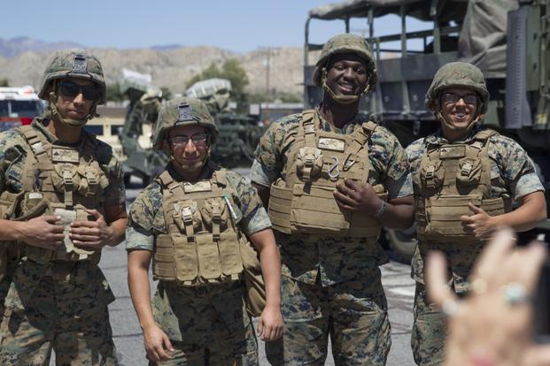 Marines with 3rd Light Armored Reconnaissance Battalion pose for a spectator's photo during the 67th annual Grubstake Days Parade along California Highway 62 in Yucca Valley, Calif., May 27, 2017.